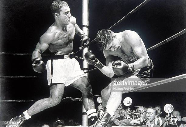 Rocky Marciano winds up an upper cut on his way to beating Roland La Starza in the Heavyweight Title fight at the Polo Grounds in New York USA...