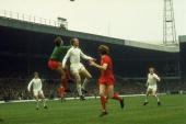 Jack Charlton of Leeds United and Liverpool goalkeeper Ray Clemence both jump for the ball during a Football League Division One match at Elland Road...