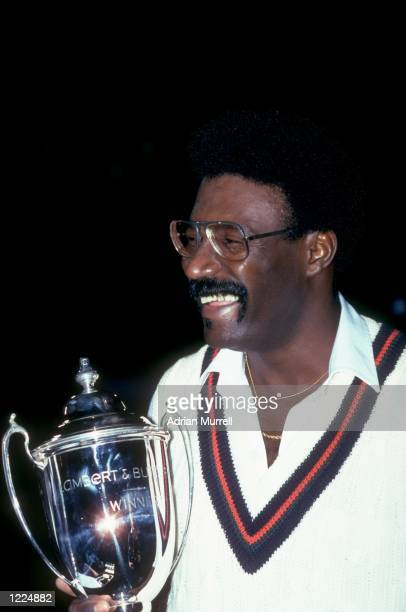 Lancashire Captain Clive Lloyd celebrates as he holds the first Lambert and Butler Cup after the final night cricket match against Leicestershire in...