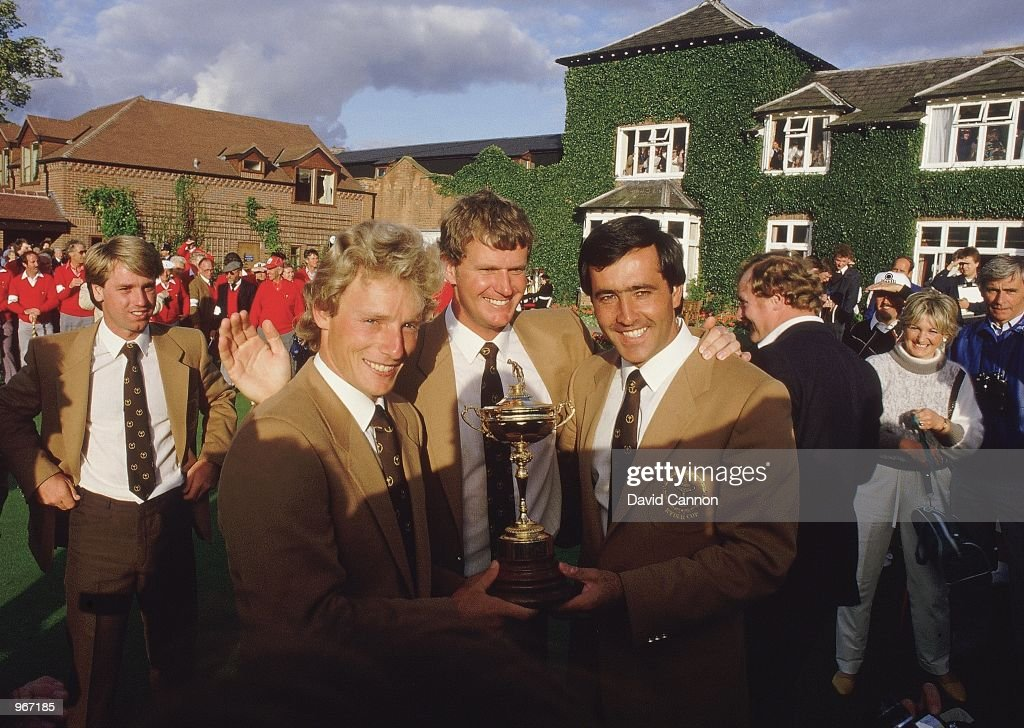 Bernhard Langer Sandy Lyle and Seve Ballesteros of the European team with the trophy after victory over the USA in the Ryder Cup at the Belfry in...