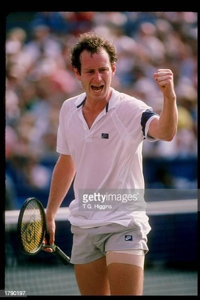 John McEnroe stands on the court during a match Mandatory Credit T G Higgins /Allsport