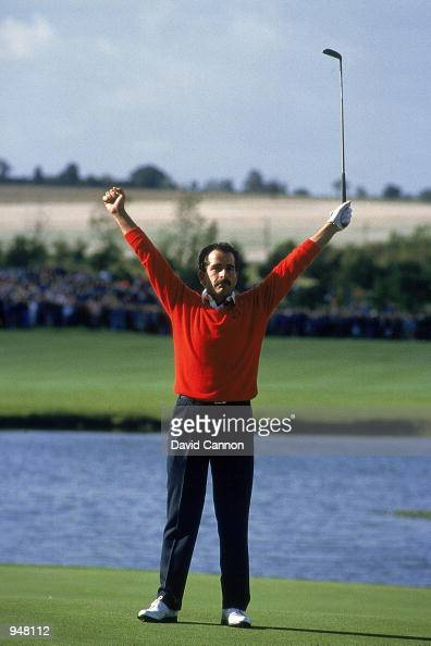 Sam Torrance of the European team celebrates on the 18th after sinking the putt to secure victory in the Ryder Cup at the Belfry in Sutton Coldfield...