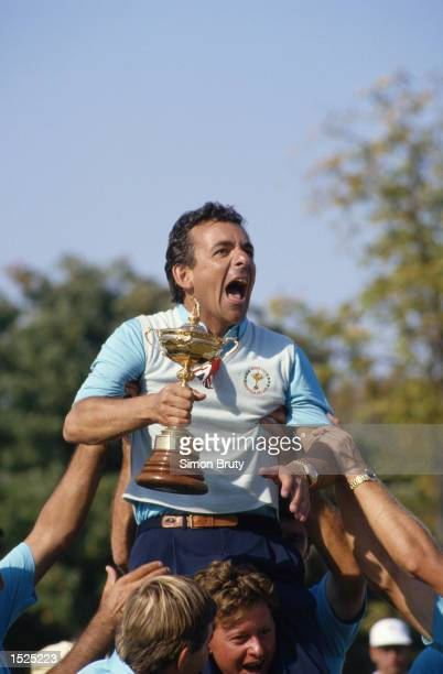 The European Captain Tony Jacklin celebrates with the trophy after victory in the Ryder Cup at Muirfield Village in Ohio USA Europe won the event...