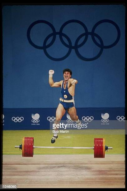 B Guidikov of Bulgaria celebrates while competing in the 200k weight lifting competition during the 1988 Summer Olympics in Seoul Korea Mandatory...