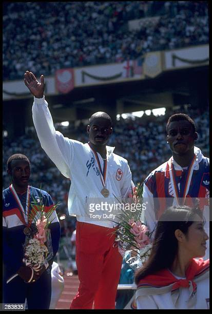 Ben Johnson of Canada Carl Lewis of the USA and Linford Christie of Great Britain on the podium after winning the 400m race at the Seoul Olympics in...