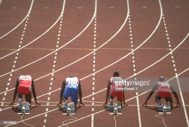 Carl Lewis of the USA Linford Christie of Great Britain Calvin Smith of the USA and Ben Johnson of Canada at the start of the 100 Metres Final at the...