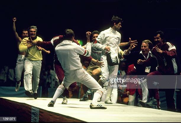 Dr Gedouari of Hungary is congratulated by the rest of the Hungarian team after winning his match in the Final of the Team Sabre Fencing event at the...