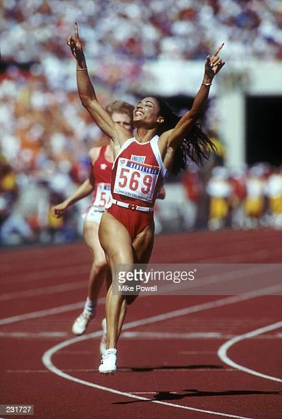 Florence GriffithJoyner of the USA celebrates after winning the 100m meter final at the 1988 Seoul Summer Olympics in Seoul South Korea...