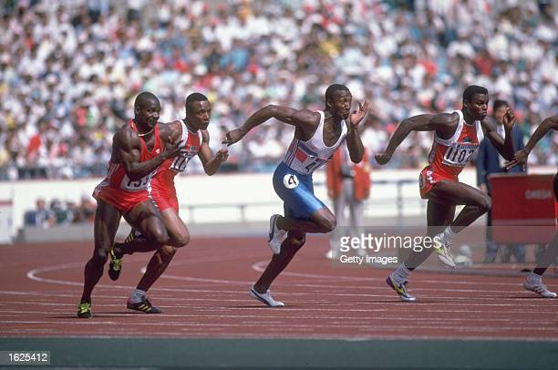 Left to Right Ben Johnson of Canada Calvin Smith of the USA Linford Christie of Great Britain and Carl Lewis of the USA sprint away from the starting...