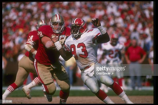 Offensive lineman Harris Barton of the San Francisco 49ers blocks Atlanta Falcons linebacker Aundray Bruce during a game at Candlestick Park in San...