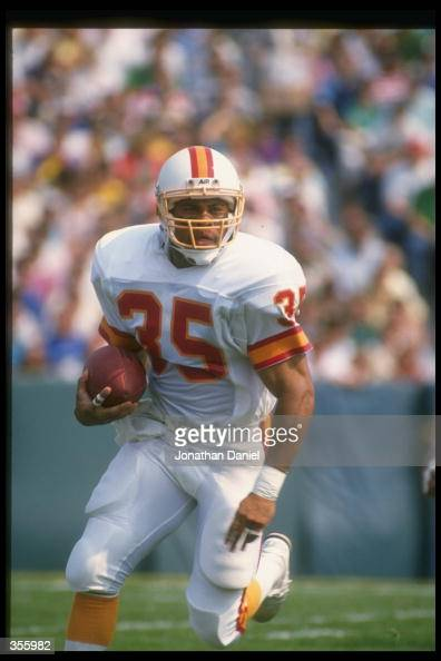 Running back Jeff Smith of the Tampa Bay Buccaneers moves the ball during a game against the Green Bay Packers at Lambeau Field in Green Bay...