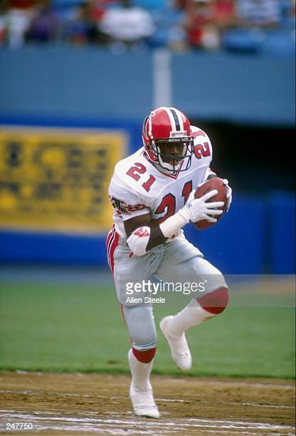 Defensive back Deion Sanders of the Atlanta Falcons runs with the ball during a game against the Los Angeles Rams at Fulton County Stadium in Atlanta...
