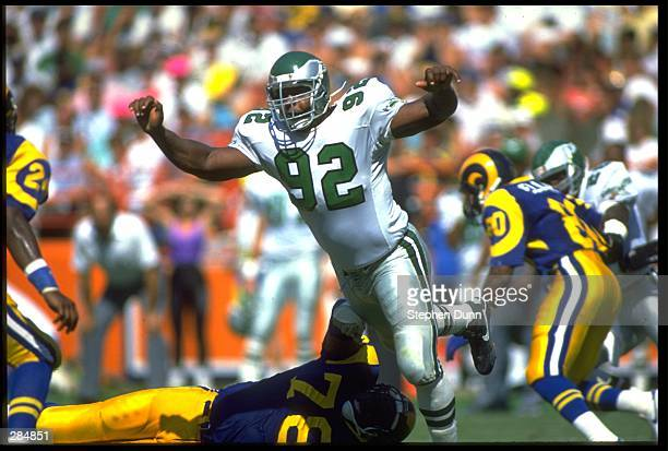Defensive end Reggie White of the Philadelphia Eagles rushes to pressure the quarterback of the Los Angeles Rams at Anaheim Stadium in Anaheim...