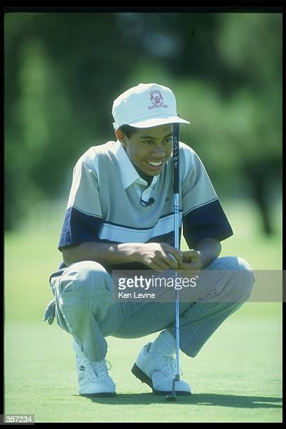 Tiger Woods putts the ball during a tournament Mandatory Credit Ken Levine /Allsport