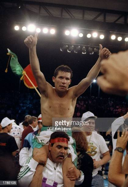 Julio Cesar Chavez raises his arms in victory after defeating Lonnie Smith at the Mirage Hotel in Las Vegas Nevada Mandatory Credit Ken Levine...