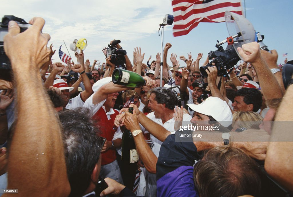 Payne Stewart of the USA pours champagne over team mate Hale Irwin after victory in the Ryder Cup at Kiawah Island in South Carolina USA Mandatory...