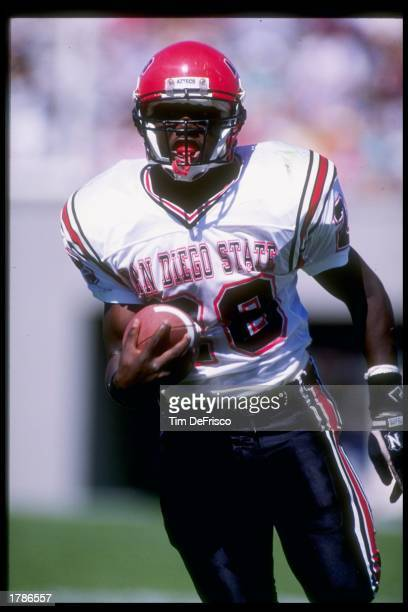 Running back Marshall Faulk of the San Diego State Aztecs runs down the field during a game against the Air Force Falcons at Falcon Stadium in...