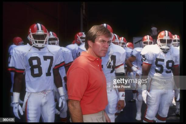 Cleveland Browns head coach Bill Belichick looks on during a game against the Los Angeles Raiders at Cleveland Stadium in Cleveland Ohio The Browns...