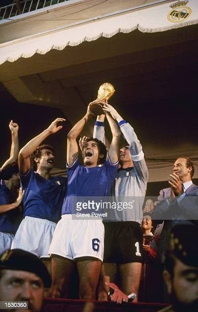 Gentile of Italy holds aloft the World Cup with team captain and goalkeeper Dino Zoff after Italy's victory over West Germany by 31 in the world cup...