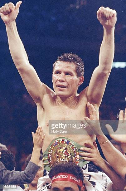 Julio C Chavez celebrates his win over Hector Camacho during a bout at the Hilton in Las Vegas Nevada Mandatory Credit Holly Stein /Allsport