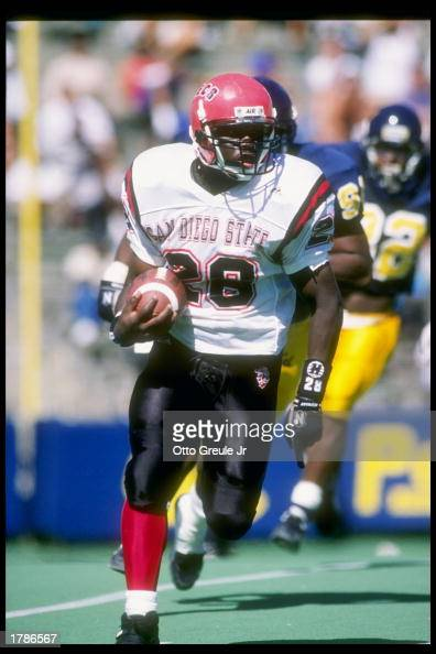 Wide receiver Marshall Faulk of the San Diego State Aztecs runs down the field during a game against the California Bears at Memorial Stadium in...