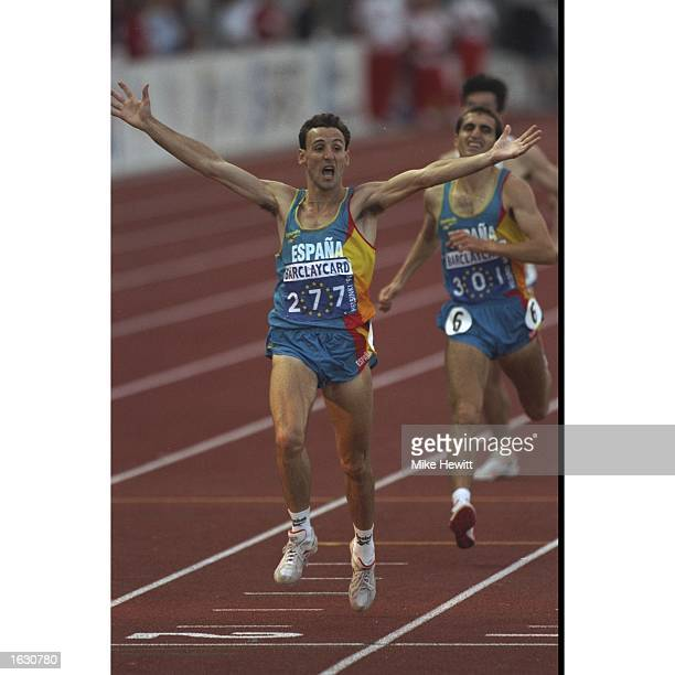 Fermin Cacho of Spain holds his arms aloft as he crosses the line to win the 1500 metres final during the European Championships at the Olympic...