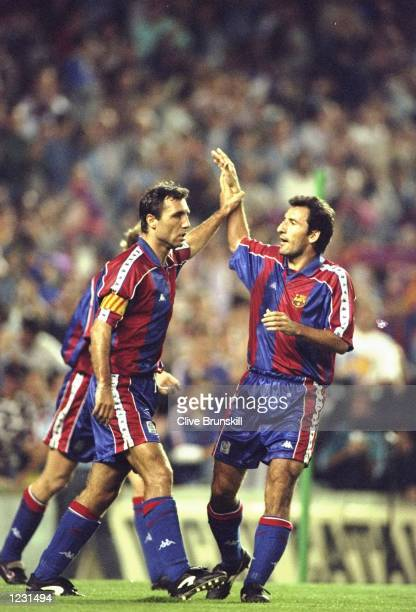 Hristo Stoichkov of Barcelona celebrates his hattrick with team mate Begiristain during a match Mandatory Credit Clive Brunskill/Allsport