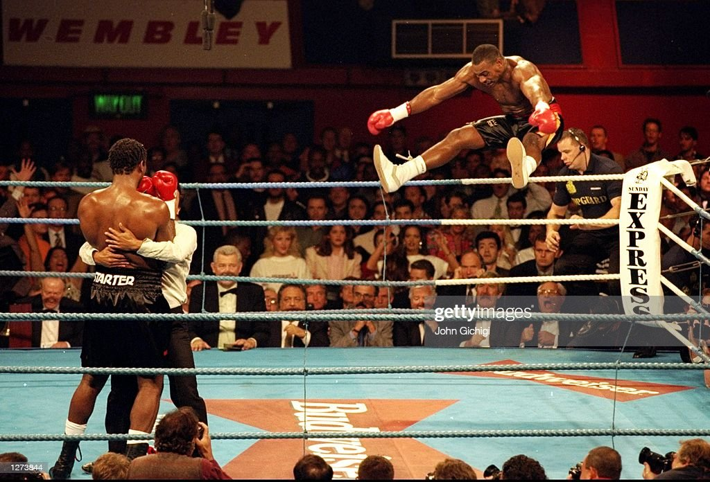 Oliver McCall of the USA jumps with joy after his TKO win over WBC Heavyweight Title holder Lewis Lennox of Great Britain at Wembley Arena in London. \ Mandatory Credit: John Gichigi /Allsport