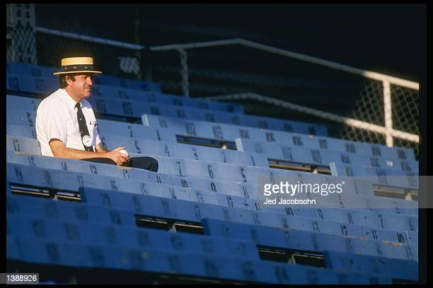 An usher sits in the stands during a game featuring the Los Angeles Dodgers at Dodger Stadium in Los Angeles California Mandatory Credit Jed...