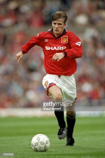 David Beckham of Manchester United in action during an FA Carling Premiership match against Bolton Wanderers at Old Trafford in Manchester England...