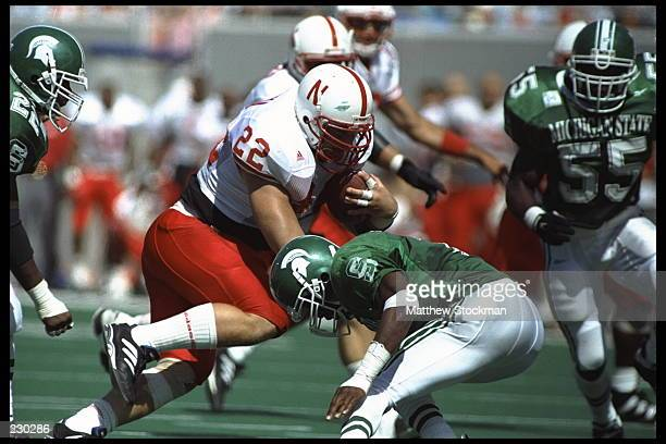 Fullback Jeff Makovicka of the Nebraska Cornhuskers carries the football during the Cornhuskers 5010 victory over the Michigan State Spartans at...