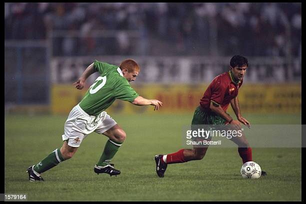 Luis Figo of Portugal is chased by Lennon of Northern Ireland during the European Championships qualifier