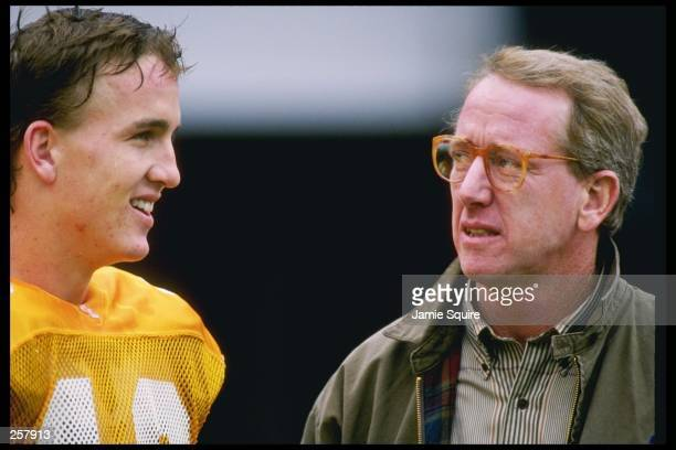 Quarter Peyton Manning of the Tennessee Volunteers talks to his dad Archie Manning after a game against the Mississippi State Bulldogs at Neyland...
