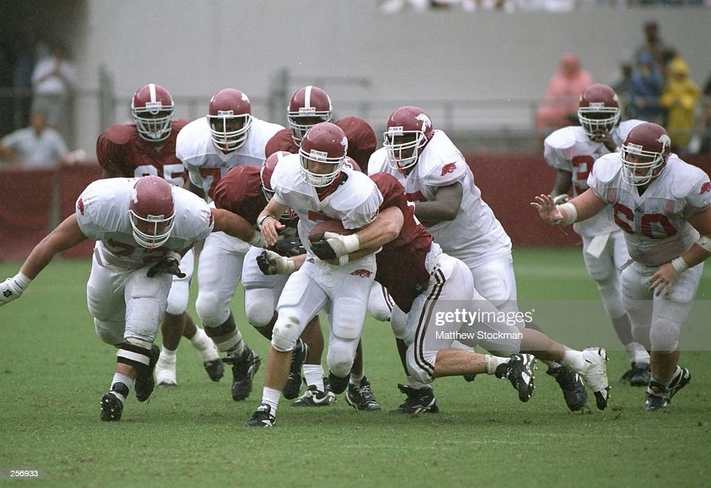 Quarterback Barry Lunney of the Arkansas Razorbacks runs down the field during a game against the Alabama Crimson Tide at BryantDenny Stadium in...