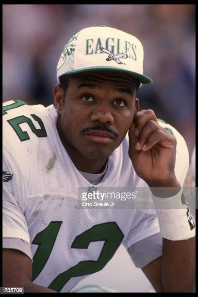 Quarterback Randall Cunningham of the Philadelphia Eagles sits on the bench during the Eagles 4817 loss to the Oakland Raiders at the Oakland...