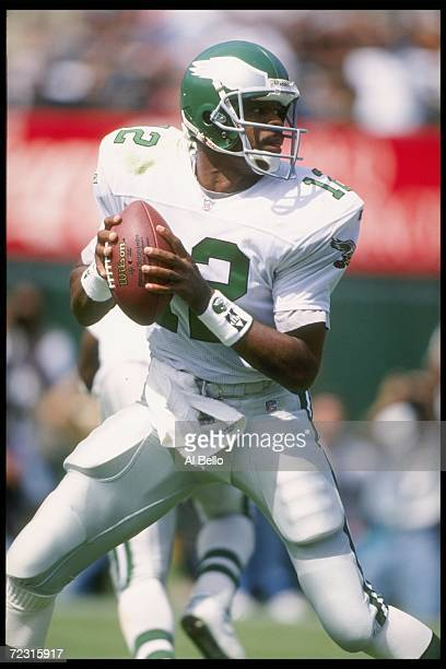 Quarterback Randall Cunningham of the Philadelphia Eagles fades back to pass against the Oakland Raiders during a game held at the Oakland Coliseum...