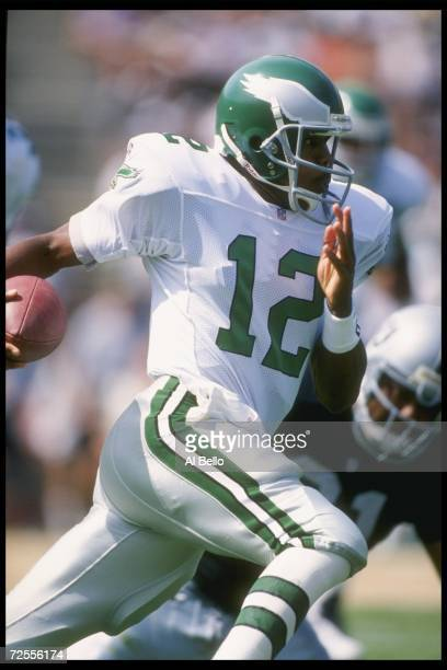 Quarterback Randall Cunningham of the Philadelphia Eagles scrambles against the Oakland Raiders during a game played at the Oakland Coliseum in...