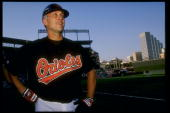 Shortstop Cal Ripken Jr of the Baltimore Orioles looks on during a game against the California Angels at Camden Yards in Baltimore Maryland during...