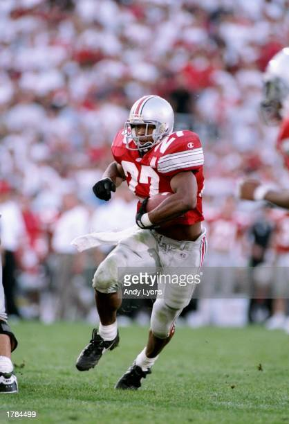 Tailback Eddie George of the Ohio State Buckeyes runs down the field during a game against the Notre Dame Fighting Irish at Ohio Stadium in Columbus...
