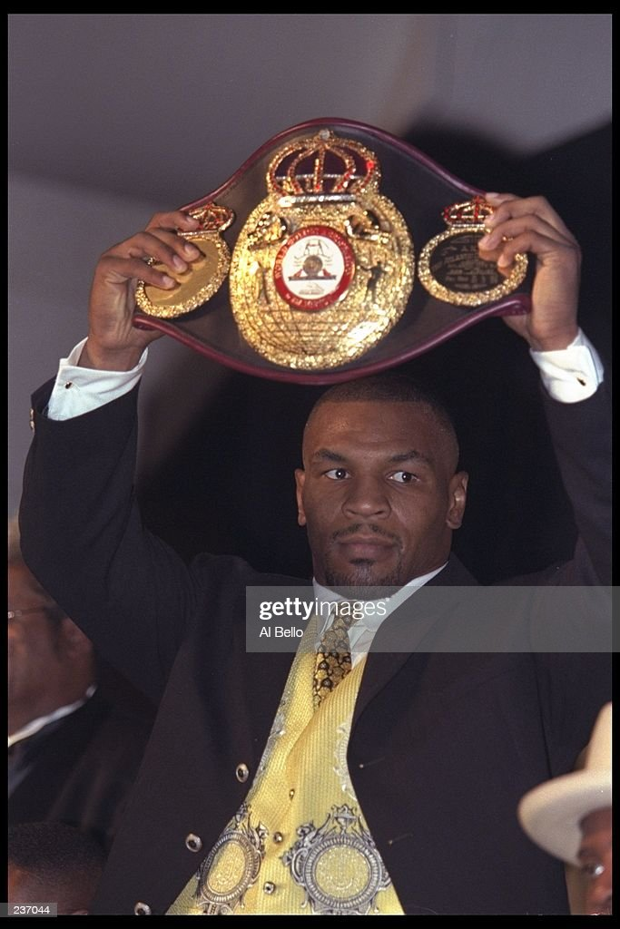 Boxer Mike Tyson poses with the WBA championship belt following his victory over Bruce Seldon in their heavy weight championship bout held at the MGM Grand Hotel and Casino in Las Vegas, Nevada. Mandatory Credit: Al Bello /Allsport