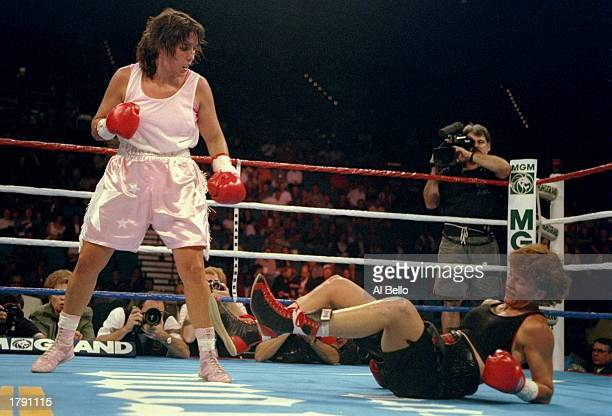 Christy Martin looks on as Melinda Robinson falls to the canvas during a bout at the MGM Grand in Las Vegas Nevada Martin won the fight with a fourth...