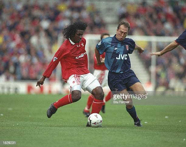 Emerson of Middlesbrough is about to be challenged by David Platt during the FA Carling Premiership match between Middlesbrough and Arsenal at the...