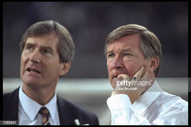 Manchester United chairman Martin Edwards stands next to his team's manager Alex Ferguson during the European champions league match between Juventus...