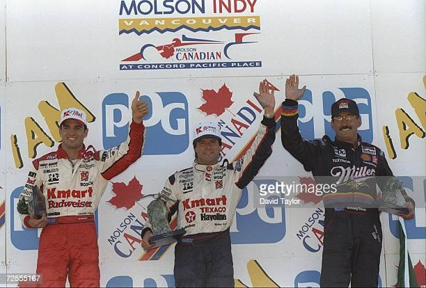 Michael Andretti center wins the Molson Indy in Vancouver British Columbia Canada Christian Fittipaldi left finished third and Bobby Rahal right...