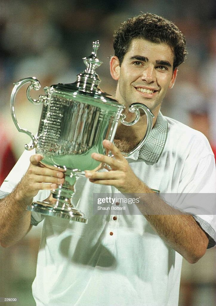 Pete Sampras of the USA smiles as he holds up the trophy after winning the mens singles final of the US Open Tennis Championships in Flushing Meadows...