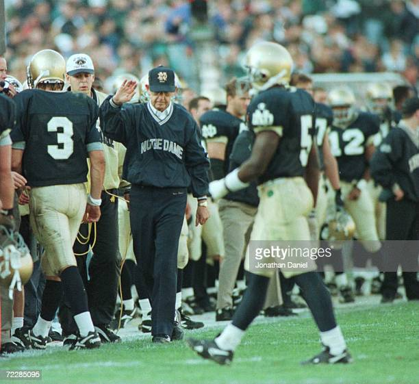 Qarterback Ron Powlus of the Notre Dame Fighting Irish is consoled by head coach Lou Holtz after throwing an interception in the final minutes of the...