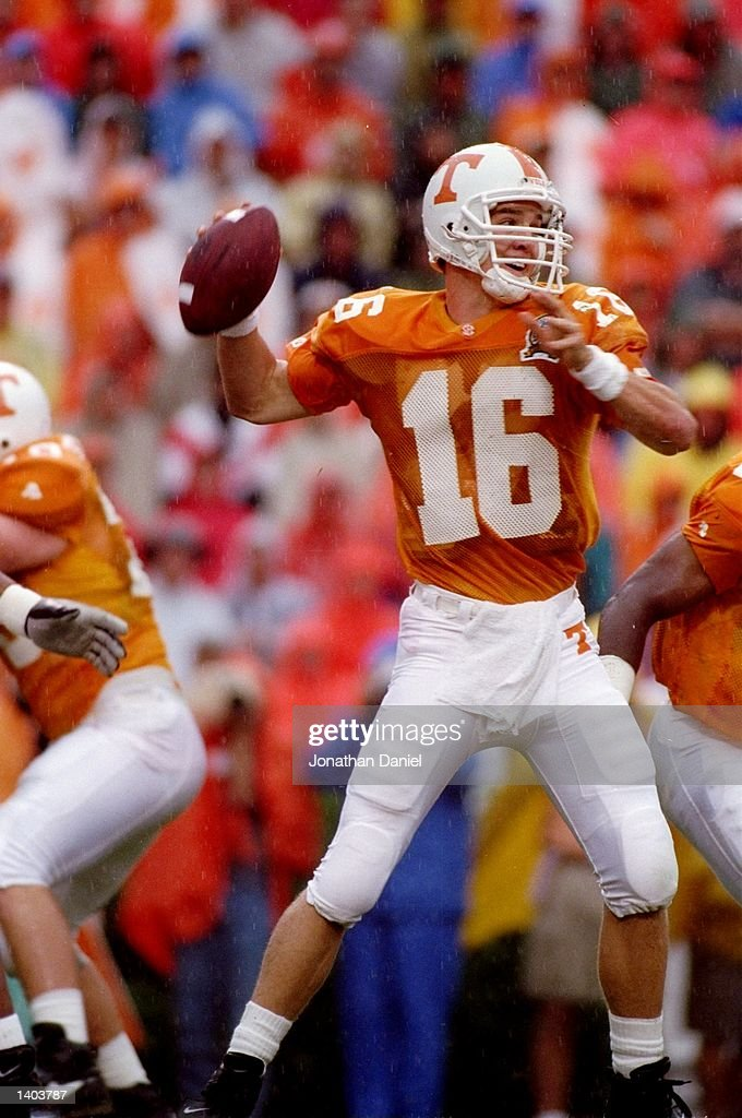 Quarterback Peyton Manning of the Tennessee Volunteers throws from the pocket during the Volunteers 3529 loss to the Florida Gators at Neyland...