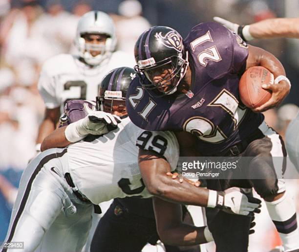 Running back Earnest Byner of the Baltimore Ravens is hit by defensive lineman Aundray Bruce of the Oakland Raiders for a one yard touchdown during...