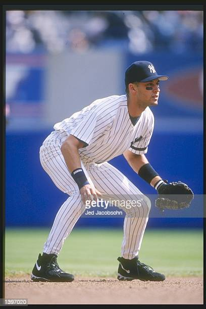 Shortstop Derek Jeter of the New York Yankees stands in position during a game against the Boston Red Sox at Yankee Stadium in Bronx New York The...
