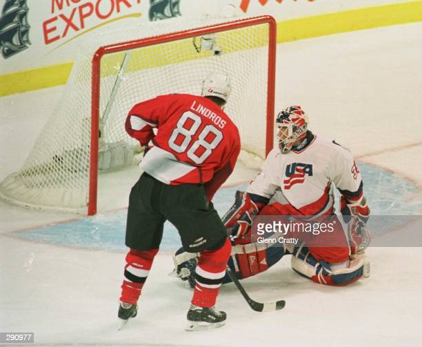 Team Canada''s Eric Lindross and USA''s Mike Richter watch Brendan Shanahan''s shot hit the back of the net for Canada''s first goal in the first...
